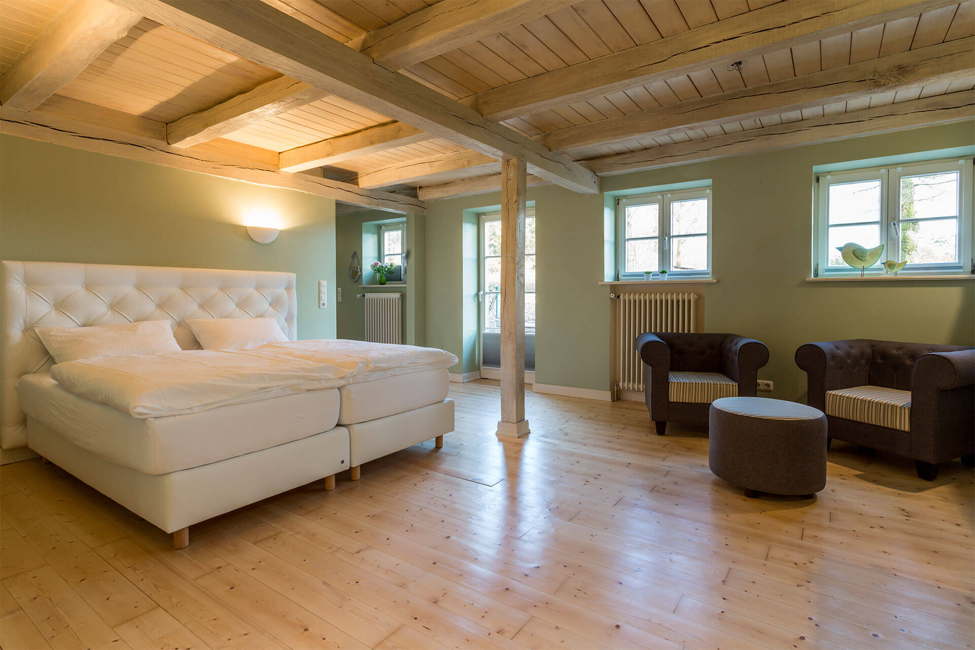 Living- and Bedroom wit boxspringbeds and cosy bed linen in the apartment Moritz
